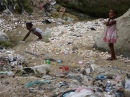 Children collect contaminated water in Haiti