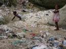 Children collect contaminated water in Haiti
